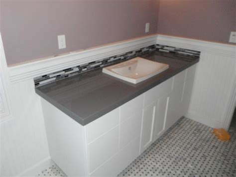 grey ceasarstone countertop with marble floor
