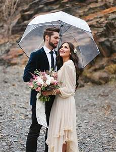 The groom39s suit eslava photography wedding photography for Umbrella wedding photos