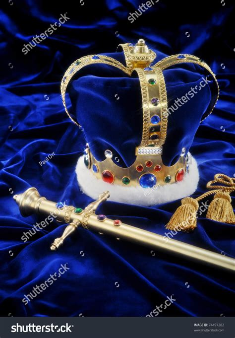 light pink velvet crown anywhere beautiful crown sword on royal blue stock photo 74497282