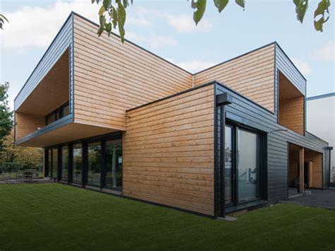 maisons en bois massif design contemporain ou traditionnel