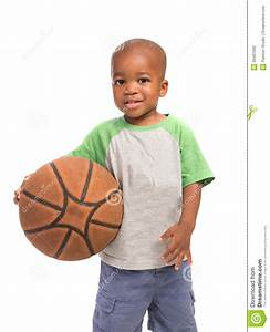2 Year Old Baby Boy Standing Holding A Basket Ball Stock ...