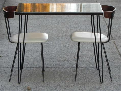 compact wood iron leather dining set nelson miller