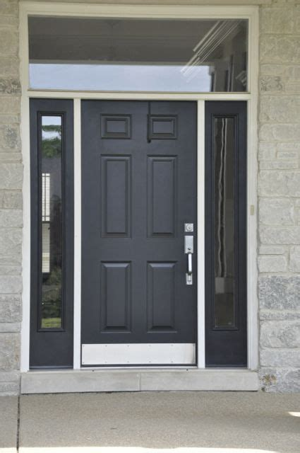 simple black front door  glass surround elegant