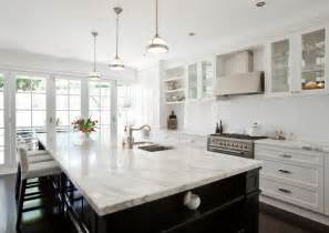 carrara marble kitchen island porchlight interiors black painted central kitchen island contrasting with white cabinetry and