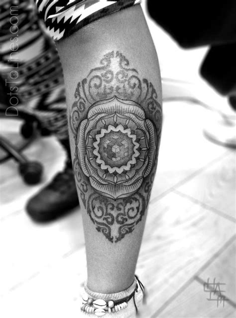 Amazing sacred geometry tattoo by Chaim Machlev of a