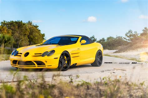 yellow mercedes slr convertible  renntech  adv