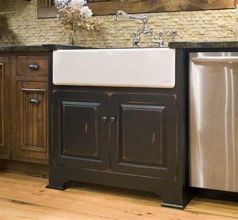 white farmhouse sink  black sink base cabinet