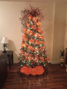burnt orange holiday xmas decor tree with our team green and orange colors let s celebrate with green and orange