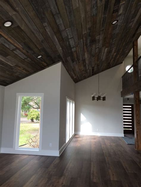 wood plank ceiling slotted front door  coretec