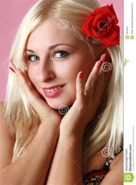 Beautiful Blonde With Red Flower In Hair Stock Image