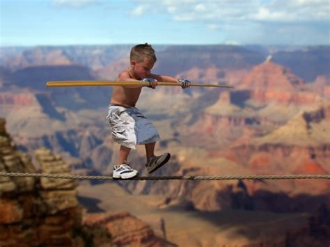 brave kid clinging   thin rope hundreds  feet   air shows great courage