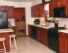 kitchen ideas with black appliances pictures of kitchens traditional medium wood kitchens cherry color page 2
