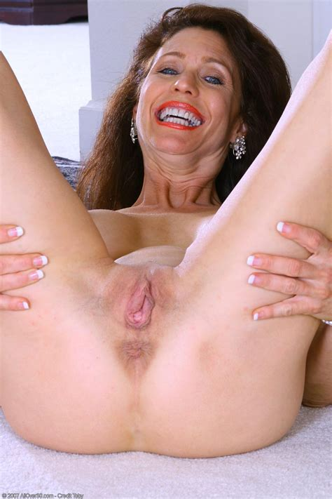 Classy Big Breasted Milf Spreads Her Pussy