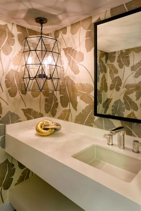 transitional powder room  palm leaf wallpaper hgtv