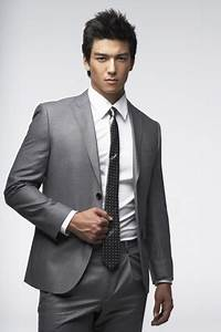 Dennis Oh...light grey suit and skinny polka dot tie ...
