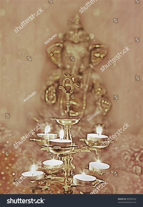 beautiful lamps sacred om symbol front stock photo