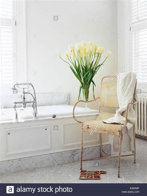 modern shabby chic modern shabby chic white bathroom with marble white tulips and old stock photo royalty free