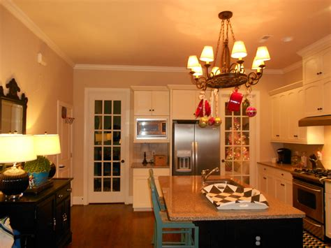 beige wall theme and white wooden kitchen cabinet added by
