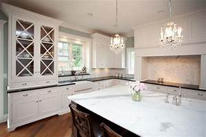 Soapstone kitchen island transitional kitchen for Kitchen colors with white cabinets with metal chandelier wall art