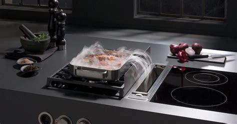 hotte aspirante d angle cuisine la hotte intégrée à la table de cuisson un système innovant