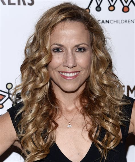 sheryl crow long curly dark blonde hairstyle  light
