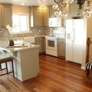 pictures of grey kitchen cabinets the gray cabinets with white appliances 7458
