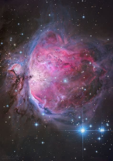gorgeous orion nebula glows  stunning red  blue light