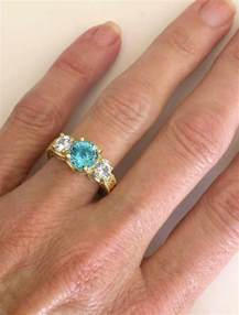 14k gold engagement ring three blue zircon rings with engraving in 14k yellow gold gr 1115