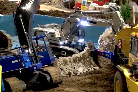 video   mini rc liebherr excavator  demo  pool  working shears breaker