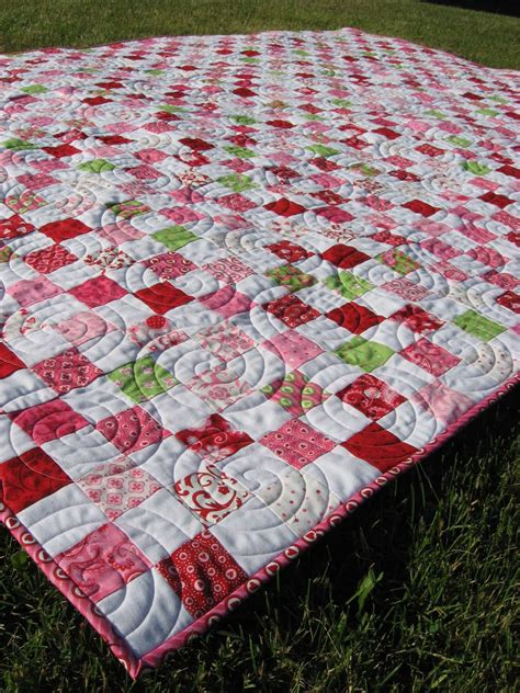 hooked  needles postage stamp quilt finished