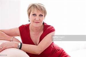 Studio Portrait Of A 57 Year Old Woman Stock Photo