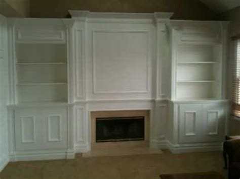 Fireplace mantel with surrounding built ins, all created