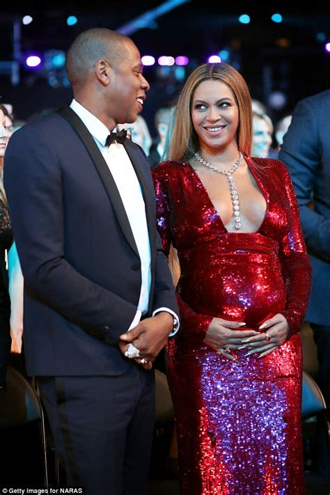 Pregnant Beyonce squeezes bump into tight dress at Grammys ...