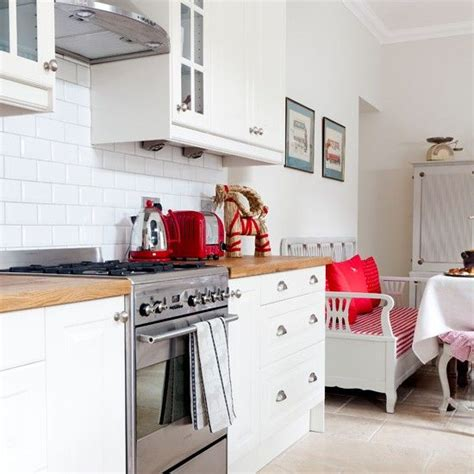 Modern White Kitchen With Red Accessories  Love It