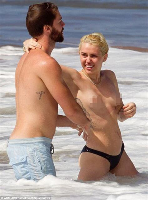 Miley Cyrus topless in the ocean with boyfriend Patrick ...
