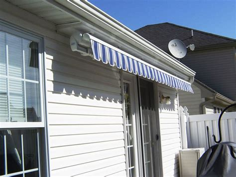 retractable blue estate awning    soffit mount awning outdoor decor homeowner