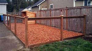 East olympia kennel with cedar chips ajb landscaping fence for Outside dog fence ideas