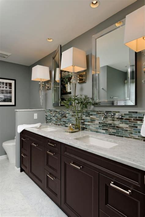 contemporary hotel style bathroom  glass tile