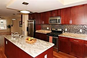 Kitchen Backsplash With Oak Cabinets And Black Appliances ...