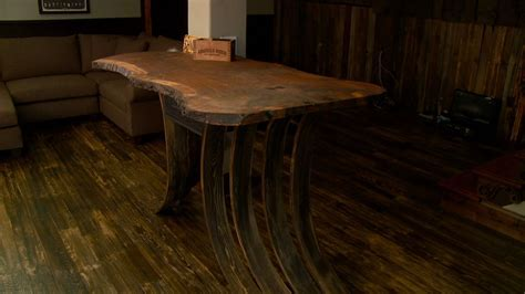 Flooring curves to support this live edge walnut bar top