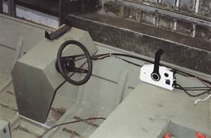 A Jon Boat With A Steering Console