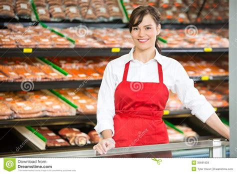 beautiful saleswoman standing  counter  stock