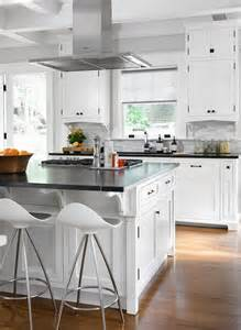 white kitchen with island white kitchen island with soapstone countertops transitional kitchen