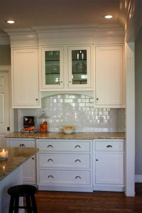 kitchen cabinets that go to the ceiling like the way they used molding to make cabinets go to 9661