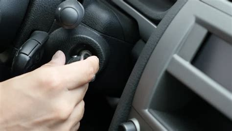 Man's Hands Holding Steering Wheel Of Car And Tapping