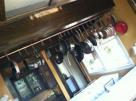 cookware   diy pot rack copper pipe   hooks pans  rolling shower