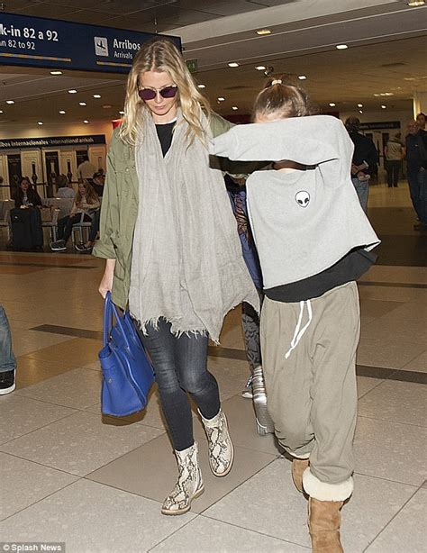 Gwyneth Paltrow Cuts A Super Casual Figure As She Jets To
