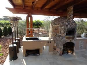 backyard kitchen design ideas cedar arbor spanning outdoor kitchen designed by leasure concepts leasure concepts