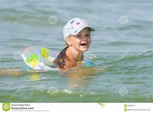 Joyful Little Girl Swimming In Pond At The Children's ...
