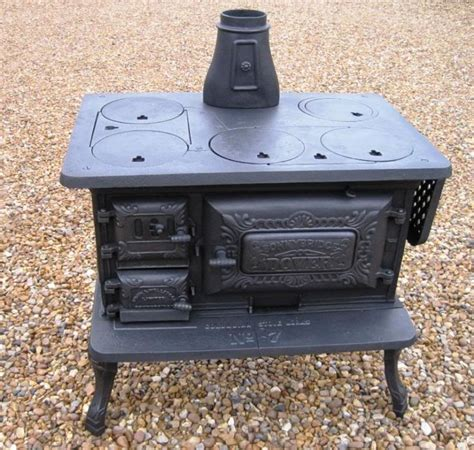 antique wood stove  kitchens pinterest